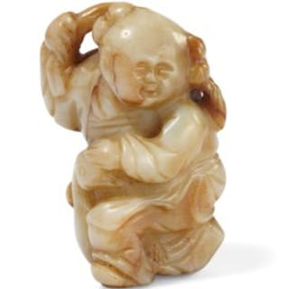 A Beige And Brown Jade Boy And Goose Carving