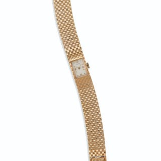 A GOLD WRISTWATCH BY J SCHULZ, RETAILED BY CARTIE...
