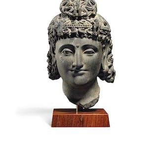 A GREY SCHIST HEAD OF A BODHISATTVA ANCIENT REGION OF GANDHARA, 2ND...