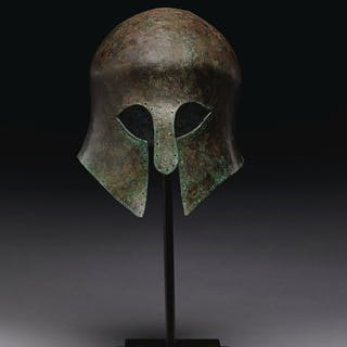 A GREEK BRONZE HELMET OF CORINTHIAN TYPE ARCHAIC PERIOD, CIRCA MID 6TH C...