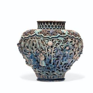 A RARE RETICULATED FAHUA JAR, GUAN MING DYNASTY (1368-1644)