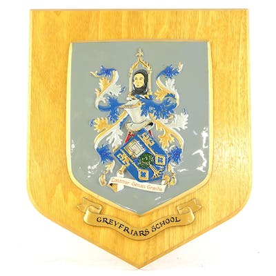 Greyfriars School coat of arms carved and painted on a