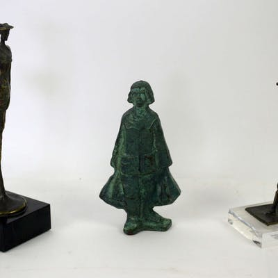 Bronze figure of a girl carrying two bags
