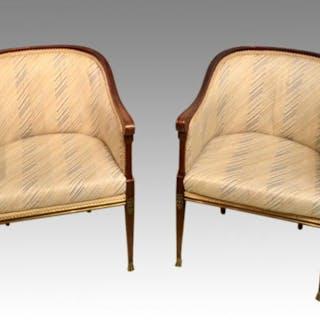Pair of French empire mahogany armchairs.