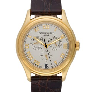 Patek Philippe Annual Calendar 5035 J 18k Off White dial 36mm Automatic watch