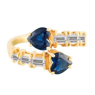 Criss-cross heart -shaped Sapphire & Diamond ring. 0.50 carats in diamonds