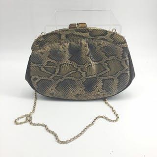 Striking python clutch shoulder bag 1970s