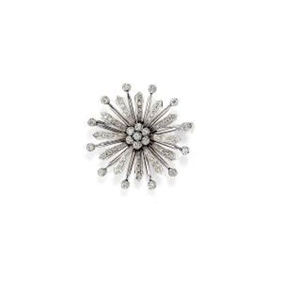 () - A 18K white gold and diamond brooch