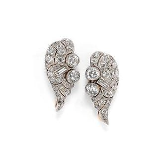 () - A 18K two-color gold and diamond earrings, circa 1930