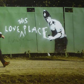 'I LOVE THIS PLACE' graffiti by Banksy photographed at Glastonbury
