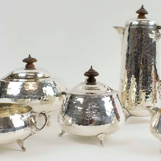 A FINE ARTS & CRAFTS PLANISHED SILVER TEA AND COFFEE SET BY CHARLES EDWARDS