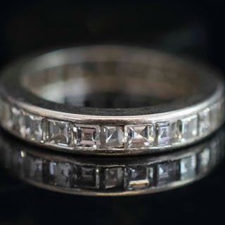A SQUARE CUT DIAMOND HOOP RING