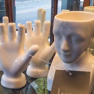 JUSTIN VAN BREDA HAND AND HEAD VASES.