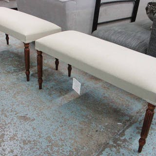 STOOLS, a pair, each with beige upholstery on reeded turned supports