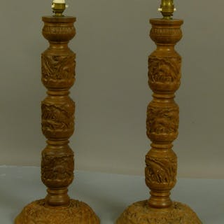 A pair of Oriental carved hardwood table lamps