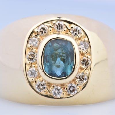 Bague en or jaune 18 ct ( 750/1000), ornée de 12 diamants ronds brillants