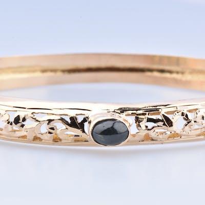 Magnifique bracelet jonc en or jaune 18 carats (750 millièmes) orné