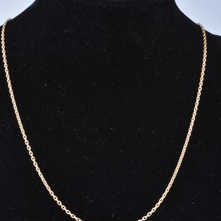 Collier long en or jaune 18 carats (750/1000). Chaine en maille figaro