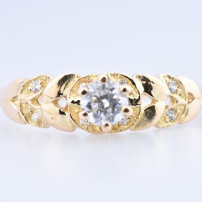 Bague solitaire en or jaune 18 carats (750 millièmes) agrémentée de