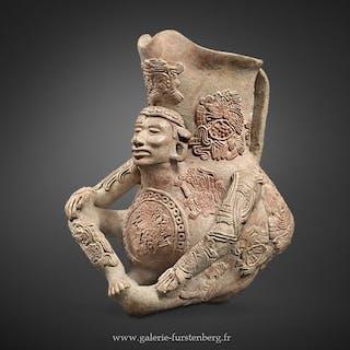 Vase aux médaillons de glyphes