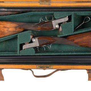 Fine Engraved Pair of W. Richards Drop Lock Shotguns