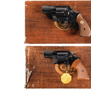 Two Colt Double Action Revolvers with Boxes