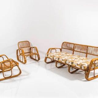 Salotto composto da un divano e due poltrone in bamboo e vimini