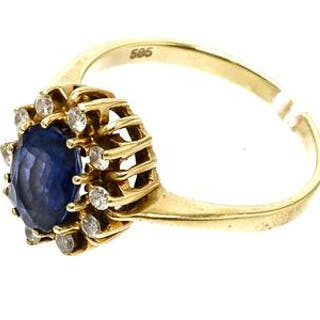 Ring med diamanter och blå sten