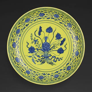 A RARE UNDERGLAZE-BLUE AND YELLOW-ENAMELLED 'LOTUS BOUQUET'CHARGER