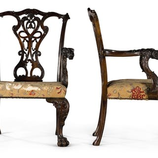 A PAIR OF GEORGE II STYLE CARVED MAHOGANY OPEN ARMCHAIRSBY HENRY