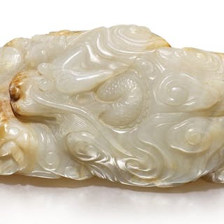 A WHITE AND RUSSET JADE 'DRAGON' BOULDER QING DYNASTY, 19TH CENTURY