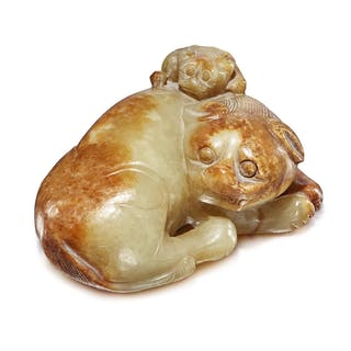 A BEIGE AND RUSSET JADE 'BUDDHIST LION' GROUP MING DYNASTY
