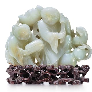 A CELADON JADE 'HEHE ERXIAN' GROUP 17TH CENTURY