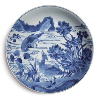 A BLUE AND WHITE 'DUCKS AND LOTUS' DISH QING DYNASTY, 17TH CENTURY