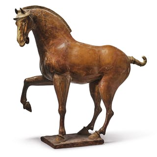 A LARGE AMBER-GLAZED POTTERY FIGURE OF A PRANCING HORSE TANG DYNASTY