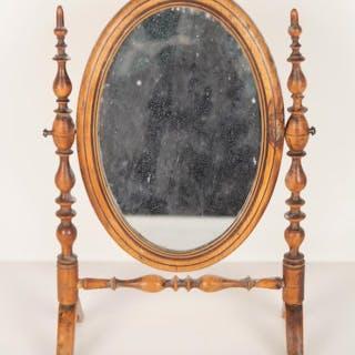 Psyché de forme ovale en bois tourné