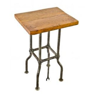 repurposed industrial four-legged durable c. 1900's machine base comprised