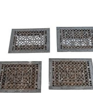 group of four matching intricately designed ornamental cast iron 19th