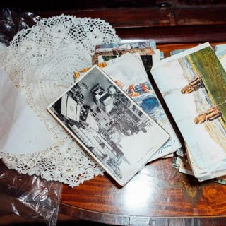 Pair of crocheted place mats and collection of 19th. C. and later postcards.