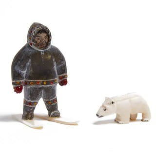 UNIDENTIFIED - MAN ON SNOW SHOES WITH BEAR CUB