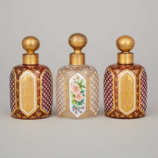 Three Bohemian Overlaid, Enameled and Gilt Glass Perfume Bottles