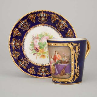 'Sèvres' 'Jeweled' Blue Ground Cup and a Saucer, late 19th/early 20th century -